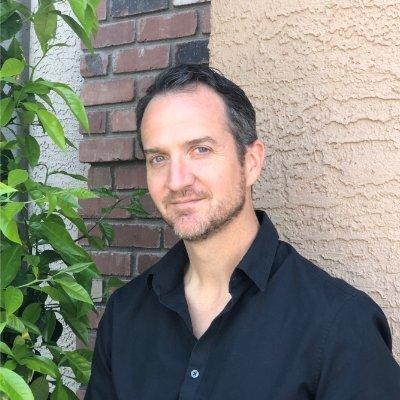 Daniel Danforth, man smiling wearing black shirt